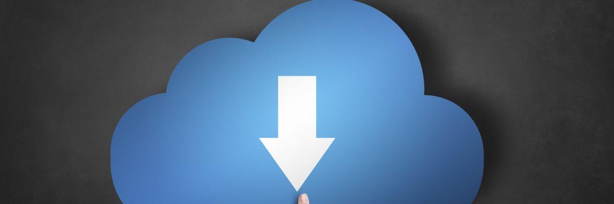 Businessman is holding a blue download cloud icon on black blackboard